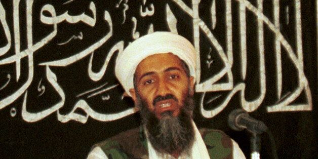 FILE - In this 1998 file photo made available on March 19, 2004, Osama bin Laden is seen at a news conference...