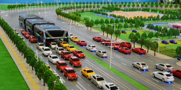 BEIJING, CHINA - MAY 20: (CHINA OUT) A scale model of a Transit Elevated Bus (TEB) runs on sand table...
