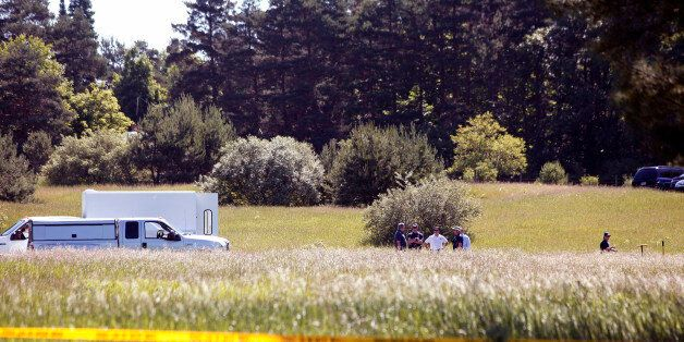 OAKLAND TOWNSHIP, MI - JUNE 17: FBI agents search a field outside Detroit for the alleged remains of...