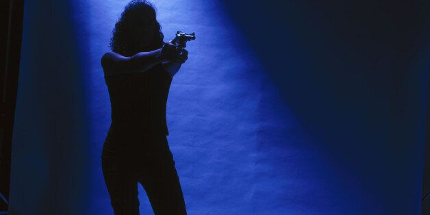 Woman in the spotlight and pointing a