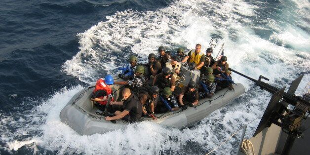 This image taken on Saturday, Feb. 13, 2010 shows a crew of U.S. sailors and Nigerian special forces...