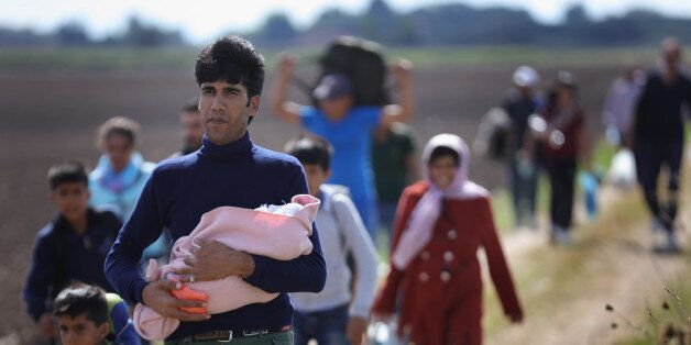 SZEGED, HUNGARY - SEPTEMBER 06: Hundreds of miigrants and refugees continue to cross the border from...