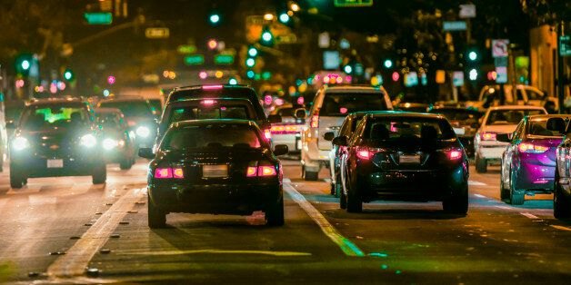 Cars driving in city traffic at