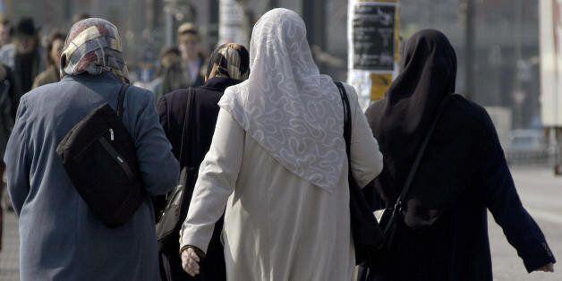 BERLIN, Germany: FILES - A file picture taken on 18 April 2005 shows Turkish women wearing headscarfs...
