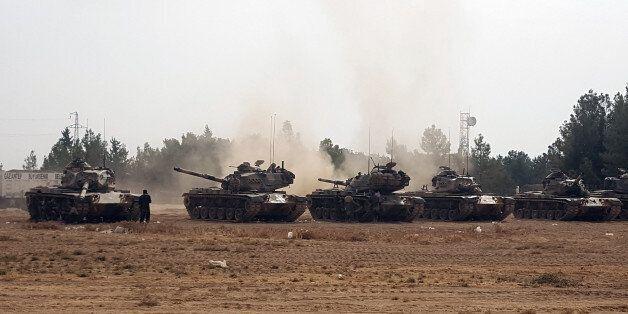 Turkish army tanks stationed near the Syrian border, in Karkamis, Turkey, Thursday, Aug. 25, 2016. Turkish...