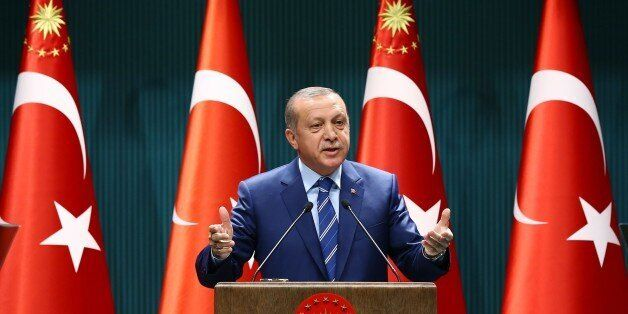 Turkish President Recep Tayyip Erdogan delivers a speech at the Presidential Palace in Ankara, Thursday,...