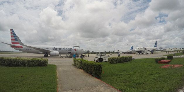 In this Friday, June 10, 2016, photo, American Airlines and JetBlue Airways charter flights wait to depart...