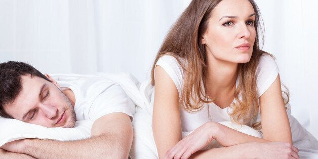 Sleeping man and thoughtful woman in
