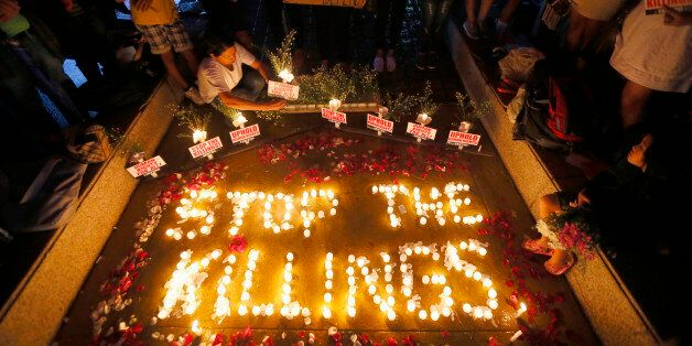 Human rights activists light candles for the victims of extra-judicial killings around the country in...