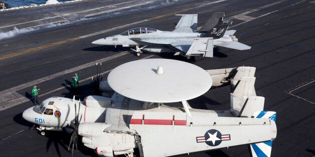 October 3, 2012 - An E-2C Hawkeye of VAW-121 Bluetails, during flight operations on the USS Dwight D....
