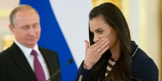 Russia's pole vaulter and Olympic champion Yelena Isinbayeva gestures after speaking at the Kremlin,...