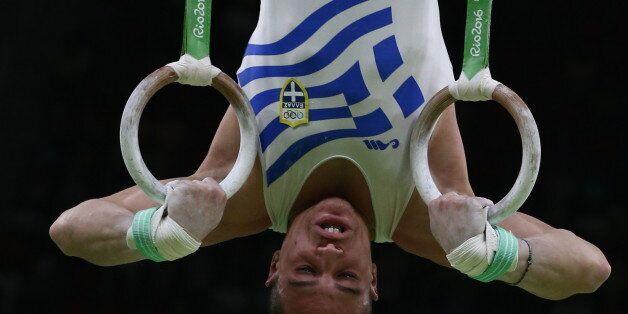 RIO DE JANEIRO, BRAZIL - AUGUST 15, 2016: Artistic gymnast Eleftherios Petrounias of Greece competes...
