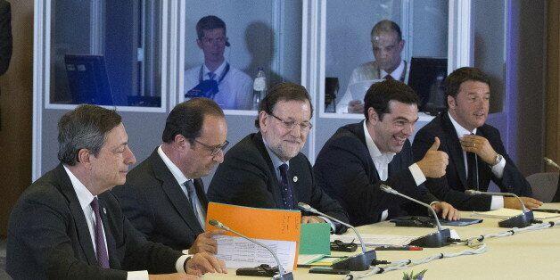 (L-R) European Central Bank President Mario Draghi, French President Francois Hollande, Spanish Prime...
