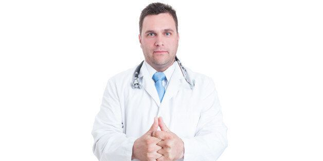 Male medic or doctor cracking his knuckles like feeling ready isolated on white background with advertising area
