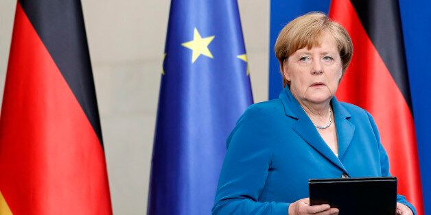 German Chancellor Angela Merkel arrives for a statement in Berlin, Germany, Saturday, July 23, 2016,...
