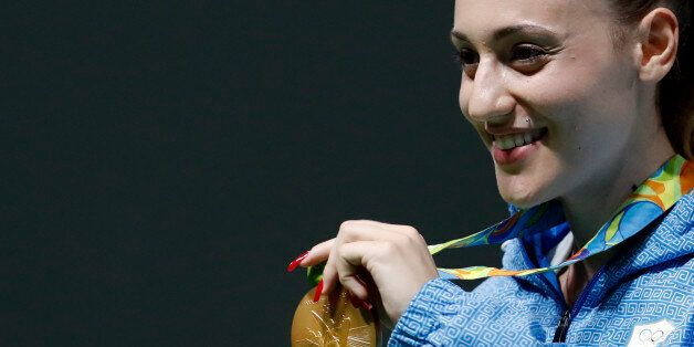 Anna Korakaki of Greece displays her gold medal following the victory ceremony for the women's 25-meter...