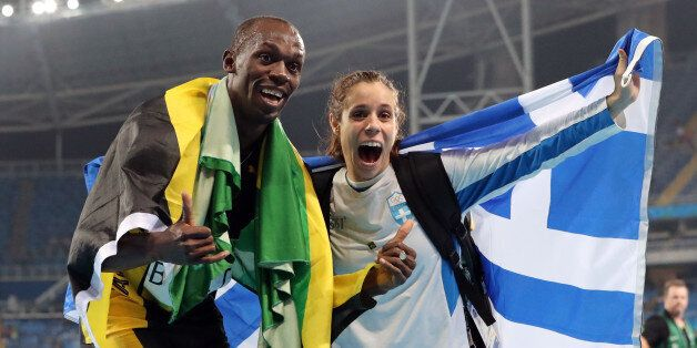 Gold medalist in the men's 4x100-meter relay final Jamaica's Usain Bolt celebrates with gold medalist...