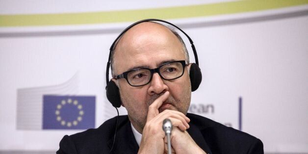 European Commissioner for Economic and Financial Affairs Pierre Moscovici listens to Greece's Finance...