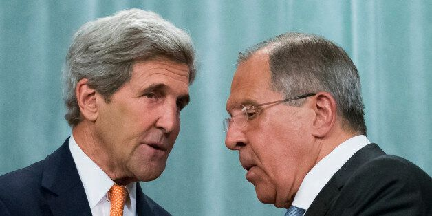U.S. Secretary of State John Kerry, left, and Russian Foreign Minister Sergey Lavrov shake hands after...