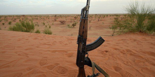 A picture taken on March 11, 2016 shows an AK 47 Kalashnikov assault rifle of the Malian army pictured...