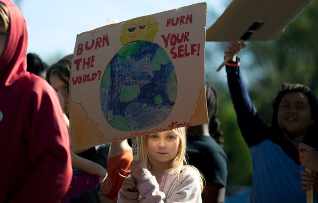 A student holds a sign while participating in a