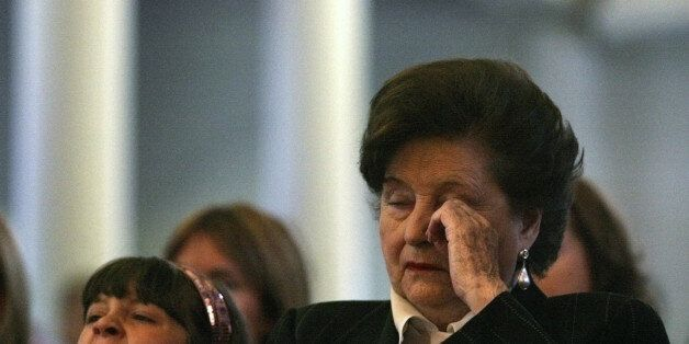 The widow of Former Chilean dictator Augusto Pinochet, Lucia Hiriart (R), attends a commemorative mass...