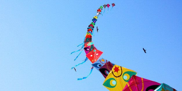 Row of kites in sky at International Kite Festival,