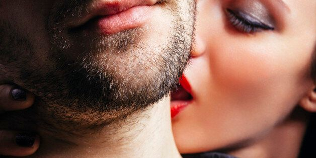 Close up of a women passionately kissing a man on the