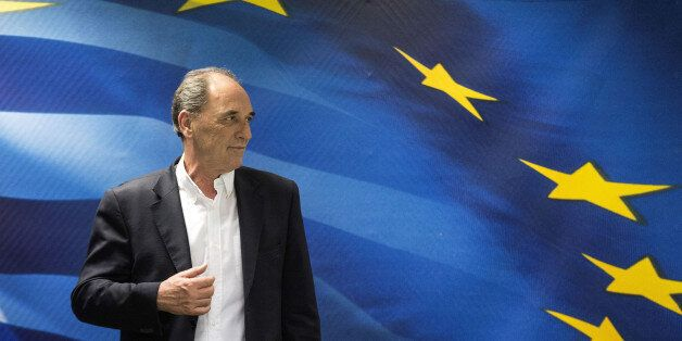 George Stathakis, Greece's economy minister, prepares to leave following a news conference in Athens,...