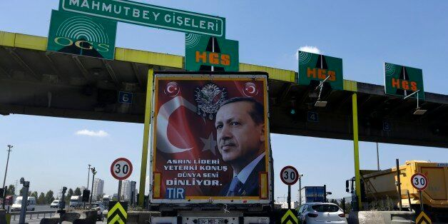 The back of a truck carries a poster portrait of Turkish President Recep Tayyip Erdogan and reading ''The...