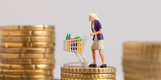 (GERMANY OUT) Germany - Woman with trolley on a pile with Euro cent coins (Photo by Classen/ullstein...
