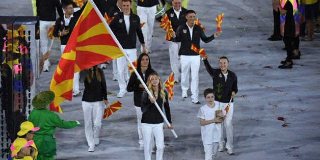 Macedonia's flagbearer Anastasia Bogdanovski leads her delegation during the opening ceremony of the...