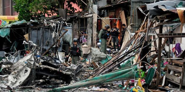 TOPSHOT - Members of a Thai bomb squad inspect the site of a car bomb blast triggered by suspected separatist...