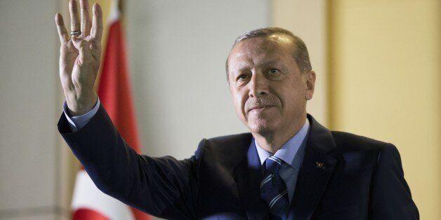 ANKARA, TURKEY - AUGUST 10: Turkish President Recep Tayyip Erdogan waves the people gathering at the...