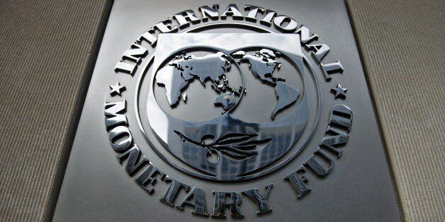 A logo is seen outside the headquarters of the International Monetary Fund June 30, 2015 in Washington,...
