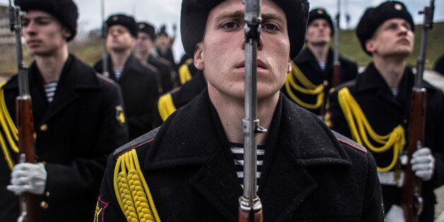 SEVASTOPOL, CRIMEA - MARCH 18: Soldiers of the honor guard prepare to march as people celebrate the first...