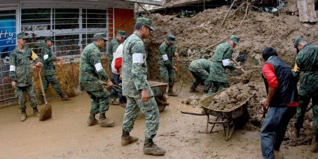 Mexican soldiers help dig out damaged homes in Xalapa community, Veracruz, Mexico on August 6, 2016.Six...