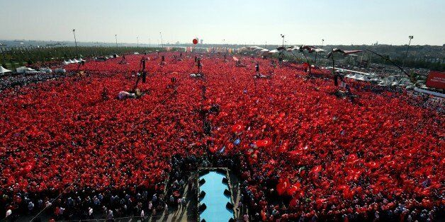 Turkish people wave flags of their country as they take part in a Democracy and Martyrs' Rally in Istanbul,...