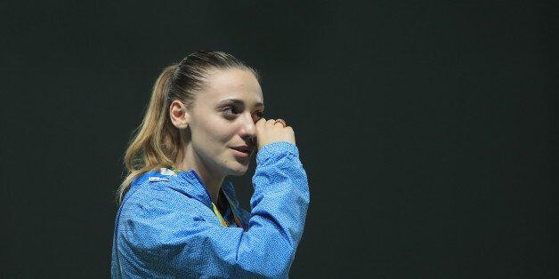 RIO DE JANEIRO, BRAZIL - AUGUST 09: Gold medalist Anna Korakaki cries on the podium during the medal...