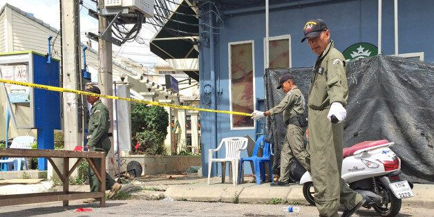 Investigators work at the scene of an explosion in the resort town of Hua Hin, 240 kilometers (150 miles)...