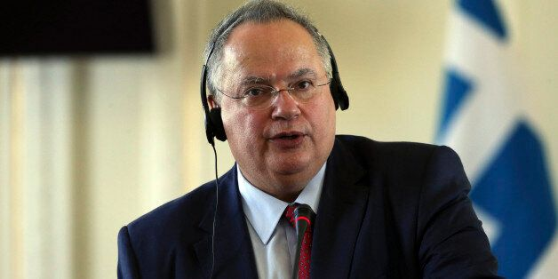 Greek Foreign Minister Nikos Kotzias speaks at a press conference with his Iranian counterpart Mohammad...