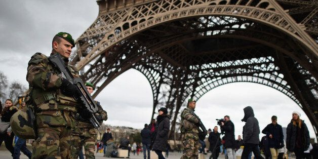 PARIS, FRANCE - JANUARY 12: French troops patrol around the Eifel Tower on January 12, 2015 in Paris,...