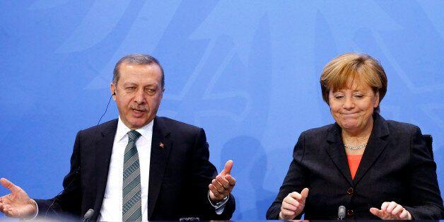 German Chancellor Angela Merkel and Turkey's Prime Minister Tayyip Erdogan address the media after talks...