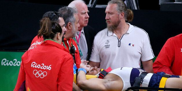 RIO DE JANEIRO, BRAZIL - AUGUST 06: Samir Ait Said of France receives medical attention after breaking...