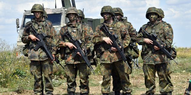 German soldiers (Bundeswehr) are pictured at a training area on August 9, 2016 in Ohrdruf. Heavily armed...