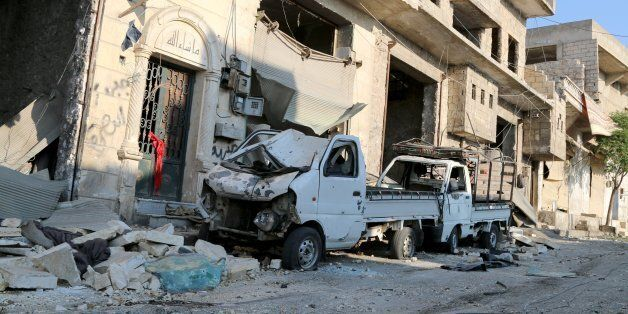 ALEPPO, SYRIA - AUGUST 7: A damaged vehicle is seen after a helicopter belonging to Syrian army hit the...