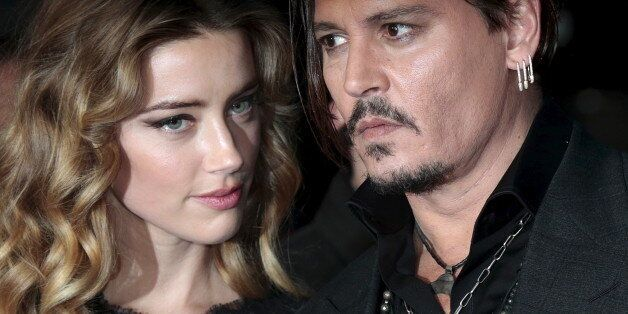 Cast member Johnny Depp and his actress wife Amber Heard arrive for the British premiere of the film