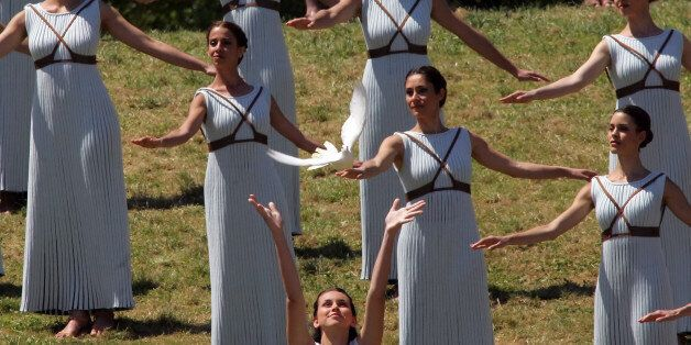 OLYMPIA, GREECE - 21 APRIL: A priestess releases a white dove during the Lighting Ceremony of the Olympic...