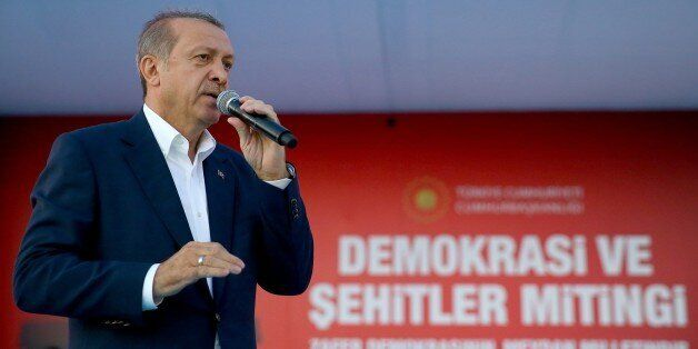 Turkish President Recep Tayyip Erdogan delivers a speech during a Democracy and Martyrs' Rally in Istanbul,...