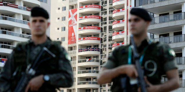 Brazilian soldiers patrol outside the Olympic Village ahead of the 2016 Summer Olympics in Rio de Janeiro,...